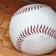 Close up of baseball in catcher's mittt with shallow depth of fi — Stock Photo