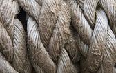 Zavřete staré lano texturu pozadí plebs — Stock fotografie