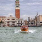 Постер, плакат: Waater taxi crossing Venice Laagoon in Italy with San Marco Piaz