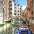 Venice Italy canal with old buildings one side and new buildings — Stock Photo