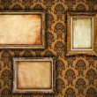 Gilded vintage frames on damask wallpaper background with grunge — Stock Photo