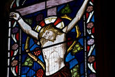 Beautiful stained glass window depicting Jesus on the cross — Stock Photo