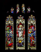 Beautiful stained glass window in 15th Century Saxon church depi — Stock Photo