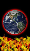 Flames heating planet Earth global warming concept — Stock Photo