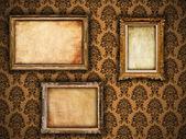 Gilded vintage frames on damask wallpaper background with grunge — Stock Photo