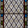 Detail of stained glass religious window in church - Stock Photo