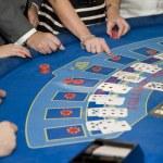 Image of men and women gambling playing blackjack cards — Stock Photo #7129975