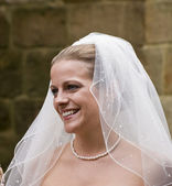 Close up portrait of attractive young bride happy and smiling naturally — Stock Photo
