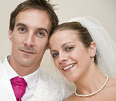Formal portrait of smiling bride and groom — Stock Photo