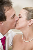 Bride and groom kissing portrait — Stock Photo