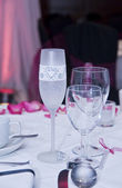 Detail of wedding champagne glass with bride written on it — Stock Photo