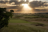 View of sunset across links golf course — Stock Photo