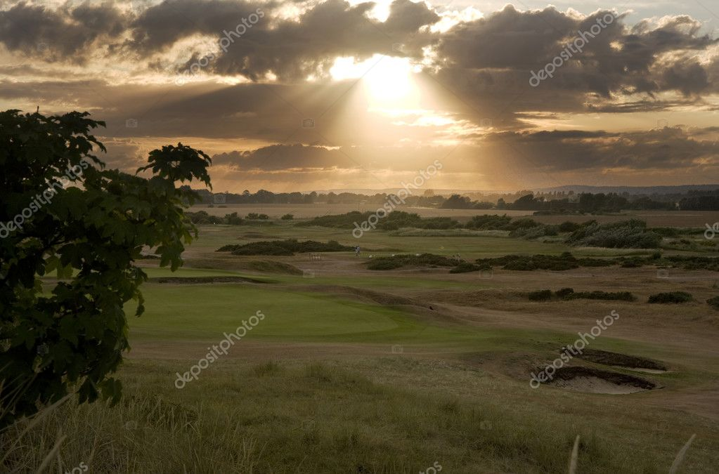 View of sunset across links golf course   #7129730