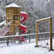 Empty children's playground in snow — Stock Photo #7131241