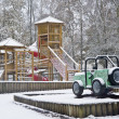 Empty children&#039;s playground in snow - Stock Photo