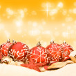 Red Christmas baubles on golden bokeh blurred background — Стоковая фотография