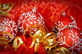 Chrsitmas Decorations red baubles and ribbons — Stock Photo