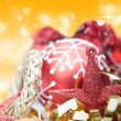 Royalty-Free Stock Photo: Red theme Christmas decorations against golden background