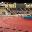 Stock Photo: Athletes night training in floodlight stadium