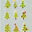 Stok Vektör: Set of Christmas trees on stickers