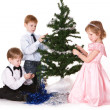 Children next to a Christmas tree — Stock Photo