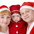 Family in Christmas costumes — Stock Photo
