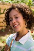 Portrait of smiling teenager girl outdoor — Stock Photo