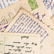 Foto Stock: Old letters and postcards as background