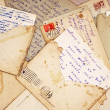 Foto Stock: Old letters and envelope as background