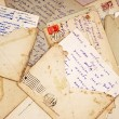 图库照片: Old letters and envelope as background