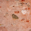 Heart on old stone wall — Stock Photo