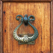 Stock Photo: Handle of a wooden door