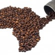 Coffee beans shaped like Africa and old coffee pot — Stock Photo