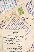 Old letters and postcards as a background — Stok fotoğraf