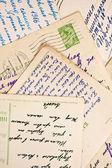 Viejas cartas y postales como telón de fondo — Foto de Stock