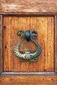 Handle of a wooden door — Stock Photo