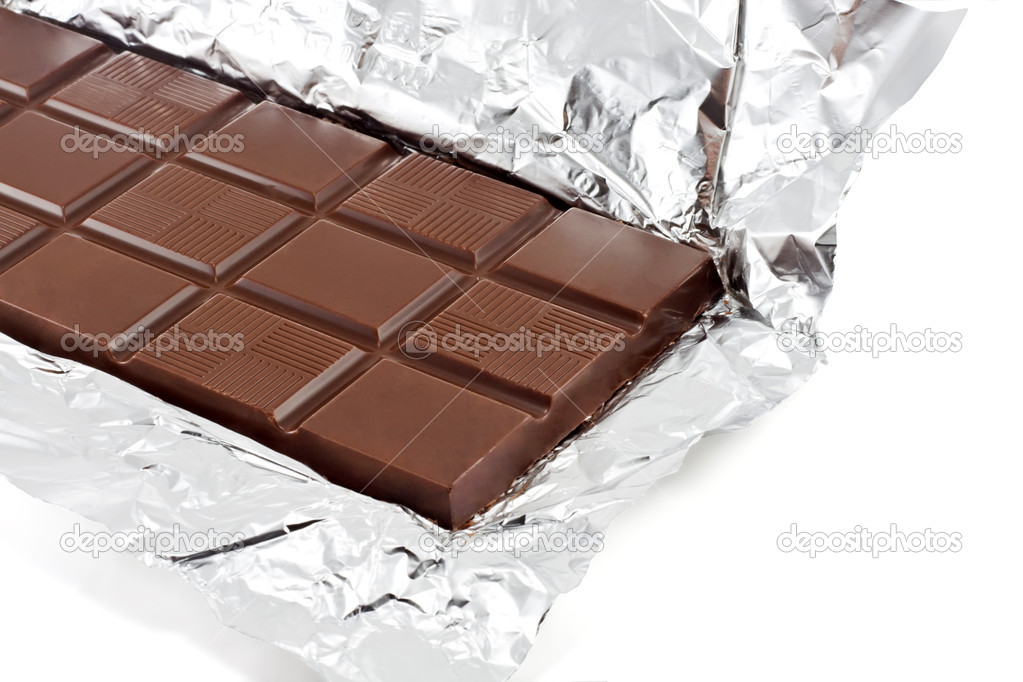 Chocolate on a foil on a white background is isolated  — Stock Photo #6844461