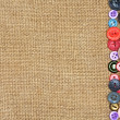 Foto Stock: Old colorful buttons on background burlap