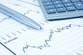 Background of business diagram, calculator and pen — Stock Photo