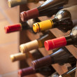 Wine bottles in rack — Stock Photo #6752161