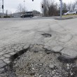Pothole in road - Stock Photo