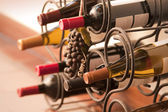Wine bottles in rack — Stock Photo