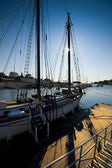 Sailboat and sun — Stock Photo