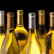 White Wine bottles on black — Stock Photo