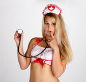 Young woman with a stethoscope — 图库照片