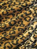 羊毛質の茶色覆われたヒョウ皮膚ファブリック — ストック写真