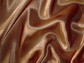 Draped chocolate-brown satin background — Stockfoto