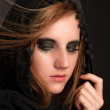 Royalty-Free Stock Photo: Black makeup and hood on a beutiful young girl