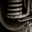 Wheels of a train with rust in black and white - Stock Photo