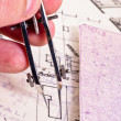 Fingers of an architect drawing a new home — Stock Photo